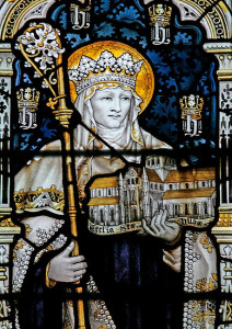 Stained glass image of a woman holding an abbey