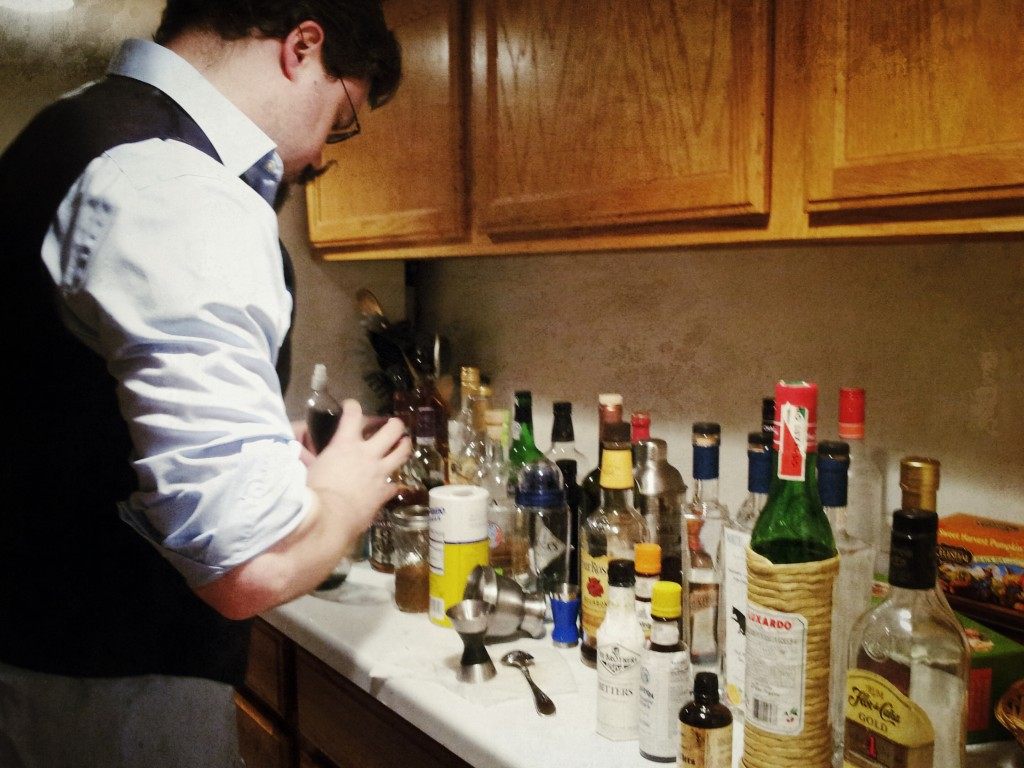 Image of a J mixing a cocktail