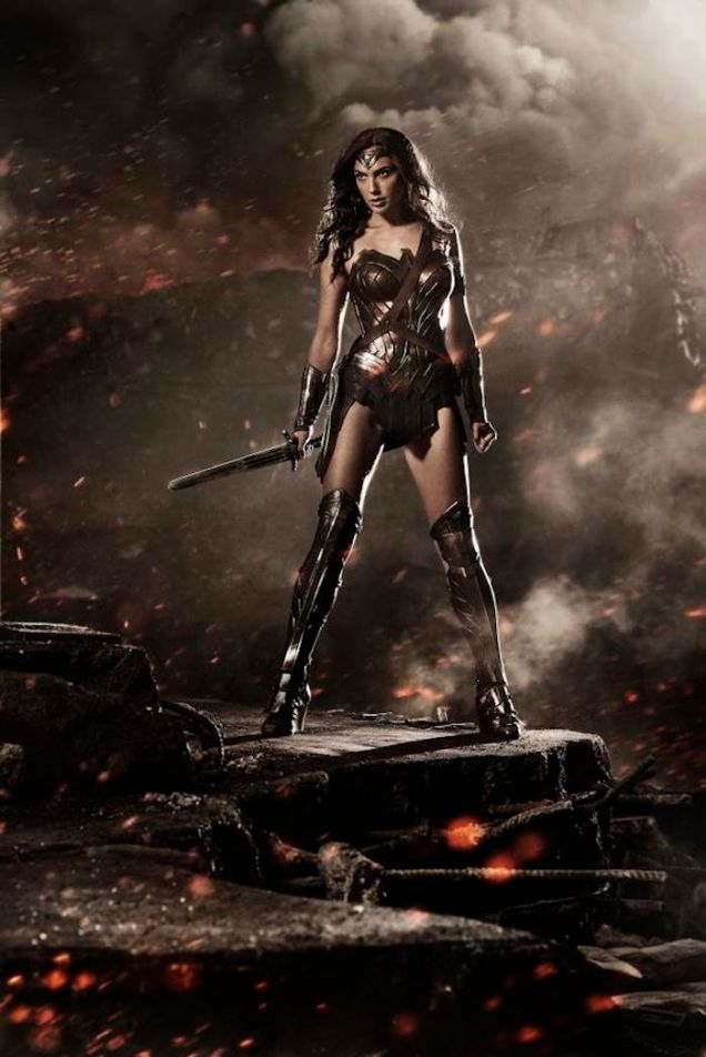 Gal Gadot as Wonder Woman posing with a sword on what appears to be volcanic terrain