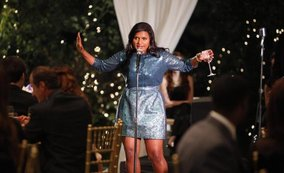 Image of Mindy Lahiri giving a drunk toast