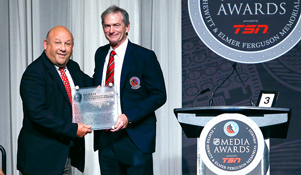 Pat Foley presented with the 2014 Foster Hewitt Memorial Award. (Chase Agnello-Dean/Chicago Blackhawks)