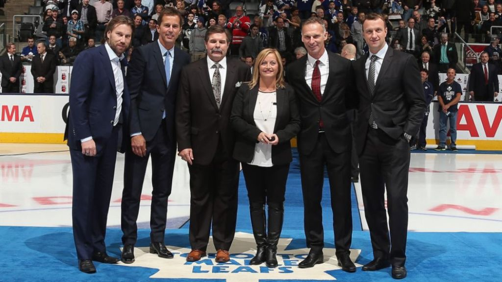 Peter Forsberg, Mike Modano, Bill McCreary, Pat Burns' widow, Line, Dominik Hasek and Rob Blake are recognized at the Hall of Fame game. (Bruce Bennett, Getty Images)
