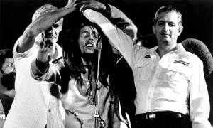 Bob Marley brings the Jamaican PM and opposition leader together on stage in a call of peace.