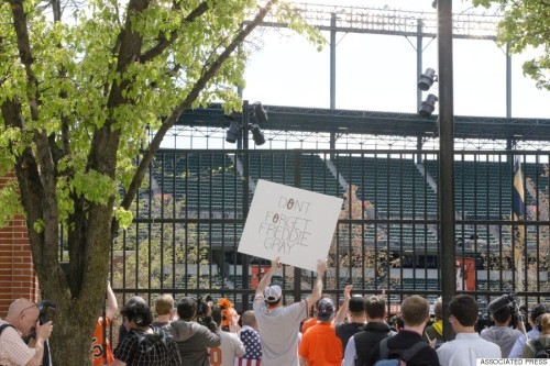 Image of Baltimore Fans holding Freddie Gray signs